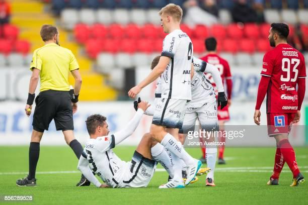 Mathias Ranegie of BK Hacken gets help up by Alexander Faltsetas of BK Hacken during the Allsvenskan match between Ostersunds FK and BK Hacken at...