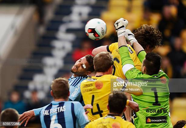 Mathias Ranegie of Djurgardens IF and Kevin Stuhr Ellegaard goalkeeper of IF Elfsborg competes for the ball during the Allsvenskan match between IF...