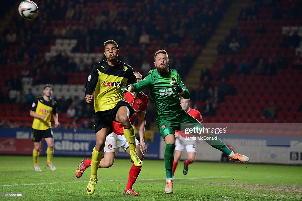Mathias Ranegie of Watford battles with Ben Hamer of Charlton during the Sky Bet Championship match between Charlton Athletic and Watford at The Valley on April 29, 2014 in London, England.