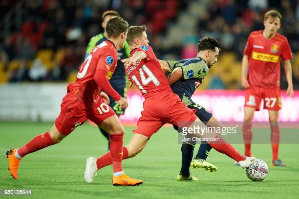 Mathias Rasmussen of FC Nordsjalland and Besar Halimi of Brondby IF compete for the ball during the Danish Alka Superliga match between FC...