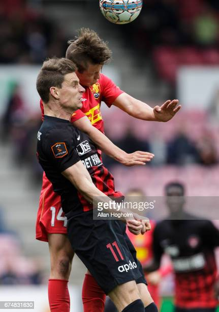 Mathias Rasmussen of FC Nordsjalland and Jonas Borring of FC Midtjylland compete for the ball during the Danish Alka Superliga match between FC...