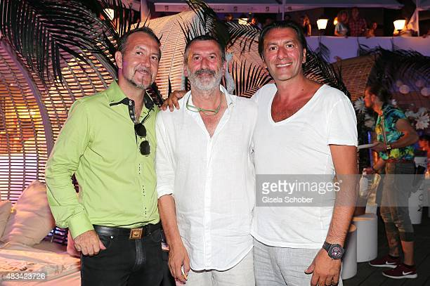 Mathias Scheffel Pino Crocamo and his brother Ugo Crocamo during the caribbean night at H'ugo's Strandbar on August 8 2015 in Starnberg Munich Germany