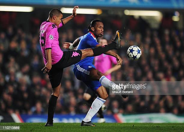Mathias Zanka Jorgensen of FC Copenhagen challenges Didier Drogba of Chelsea during the UEFA Champions League round of sixteen second leg match...