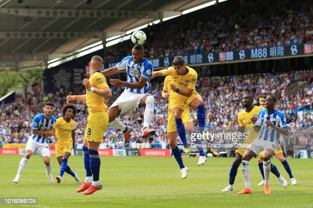 Mathias Zanka Jorgensen of Huddersfield battles for a header with Alvaro Morata of Chelsea during the Premier League match between Huddersfield Town...