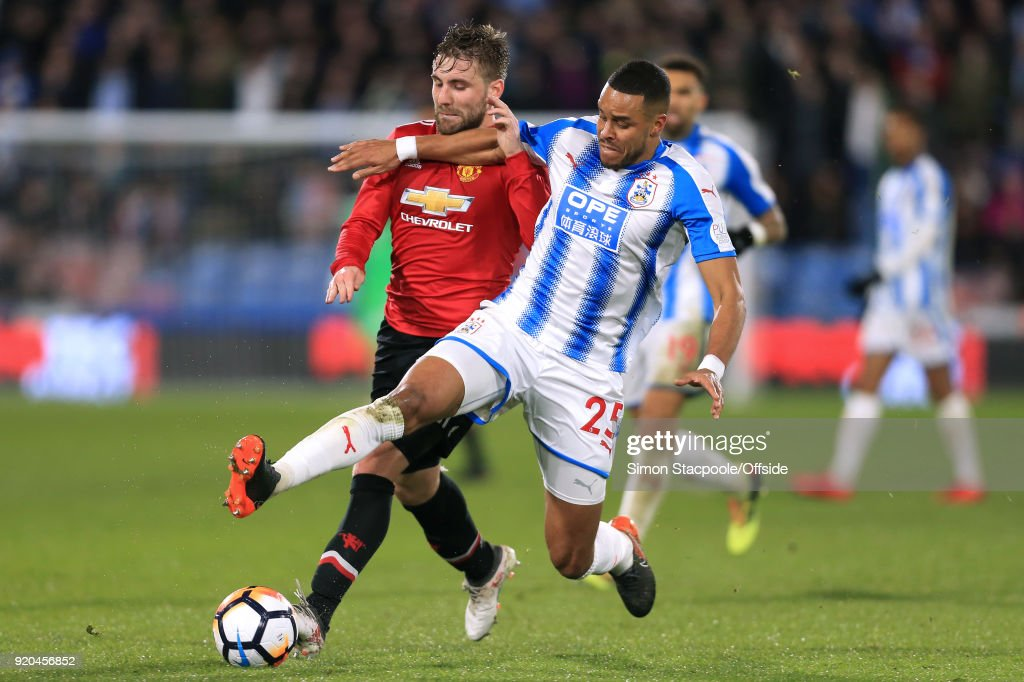 Mathias Zanka Jorgensen of Huddersfield battles with Luke Shaw of Man Utd during The Emirates FA Cup Fifth Round match between Huddersfield Town and Manchester United at the John Smith's Stadium on February 17, 2018 in Huddersfield, England.