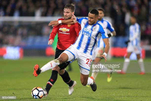 Mathias Zanka Jorgensen of Huddersfield battles with Luke Shaw of Man Utd during The Emirates FA Cup Fifth Round match between Huddersfield Town and...