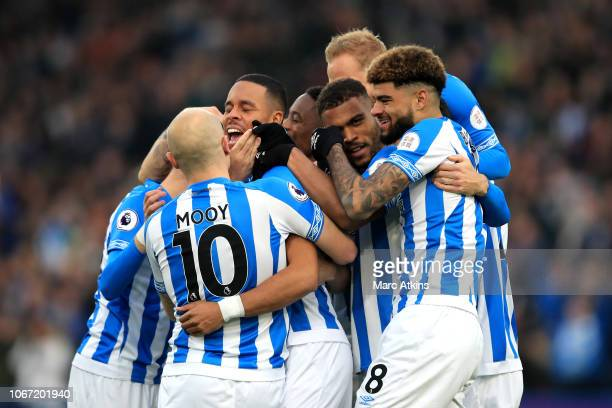 Mathias Zanka Jorgensen of Huddersfield Town celebrates with teammates after scoring his team's first goal during the Premier League match between...
