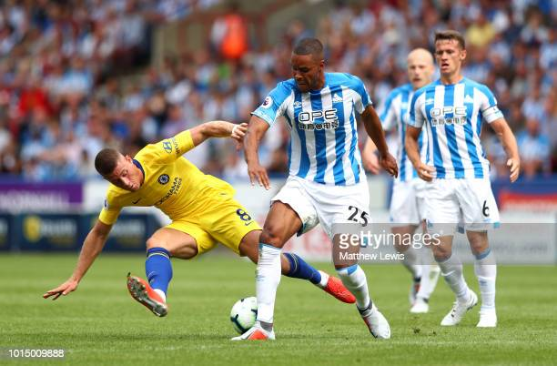 Mathias Zanka Jorgensen of Huddersfield Town is challenged by Ross Barkley of Chelsea during the Premier League match between Huddersfield Town and...