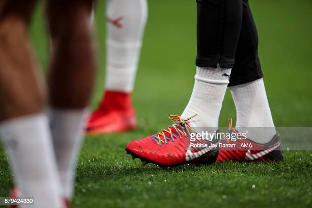 Mathias Zanka Jorgensen of Huddersfield Town wears rainbow laces in support of LGBT during the Premier League match between Huddersfield Town and...