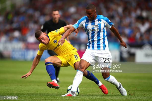 Mathias Zanka of Huddersfield Town in action with Ross Barkley of Chelsea during the Premier League match between Huddersfield Town and Chelsea FC at...
