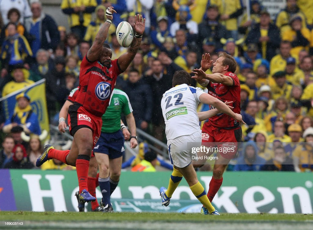 Mathieu Bastareaud (L) and Jonny Wilkinson charge down a late drop goal attempt by David Skrela during the Heineken Cup final match between ASM Clermont Auvergne and RC Toulon at the Aviva Stadium on May 18, 2013 in Dublin, Ireland.