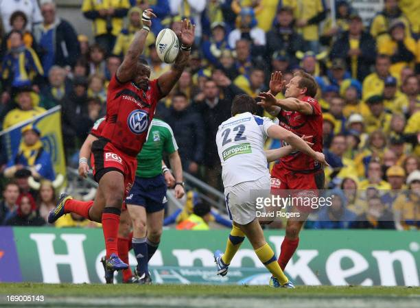 Mathieu Bastareaud and Jonny Wilkinson charge down a late drop goal attempt by David Skrela during the Heineken Cup final match between ASM Clermont...