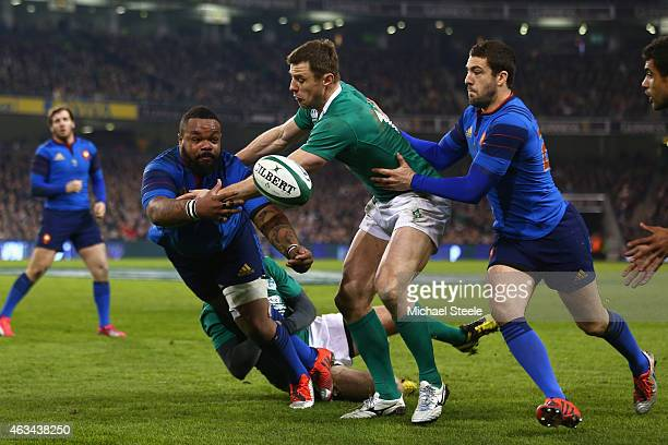 Mathieu Bastareaud of France feeds a pass as Tommy Bowe of Ireland closes in during the RBS Six Nations match between Ireland and France at the Aviva...