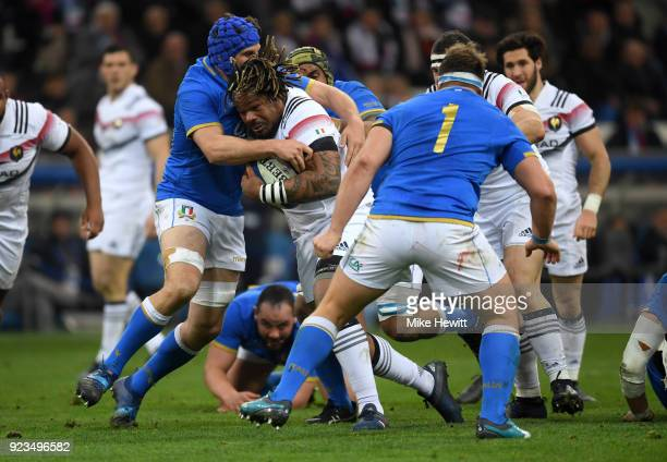 Mathieu Bastareaud of France is tackled by Dean Budd of Italy during the NatWest Six Nations match between France and Italy at Stade Velodrome on...