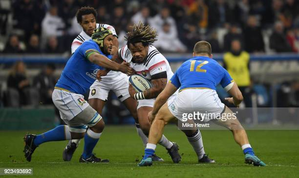 Mathieu Bastareaud of France is tackled by Maxime Mbanda and Tommaso Castello of Italy during the NatWest Six Nations match between France and Italy...
