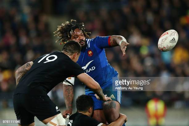 Mathieu Bastareaud of France offloads in a tackle during the International Test match between the New Zealand All Blacks and France at Westpac...