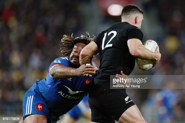 Mathieu Bastareaud of France tackles Ryan Crotty of the All Blacks during the International Test match between the New Zealand All Blacks and France...