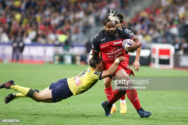 Mathieu Bastareaud of RC Toulon takes on Morgan Parra of ASM Clermont Auvergne during the Top 14 final match between ASM Clermont Auvergne and RC...