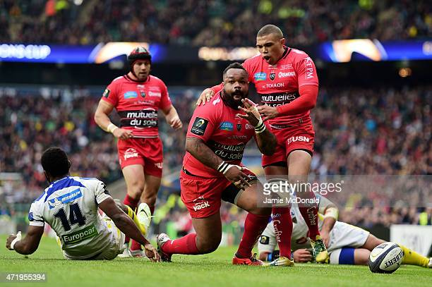Mathieu Bastareaud of Toulon celebates with teammate Bryan Habana of Toulon after scoring his team's first try during the European Rugby Champions...