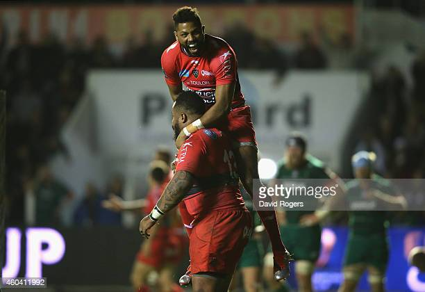 Mathieu Bastareaud of Toulon is congratulated by team mate Delon Armitage after scoring a try during the European Rugby Champions Cup pool three...