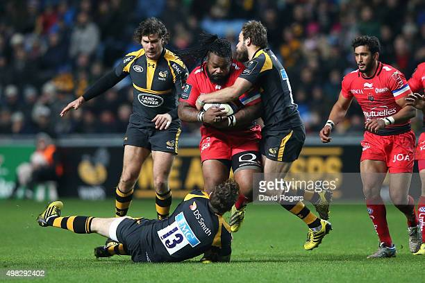 Mathieu Bastareaud of Toulon is tackled by Elliot Daly and Ruaridh Jackson during the European Rugby Champions Cup match between Wasps and Toulon at...