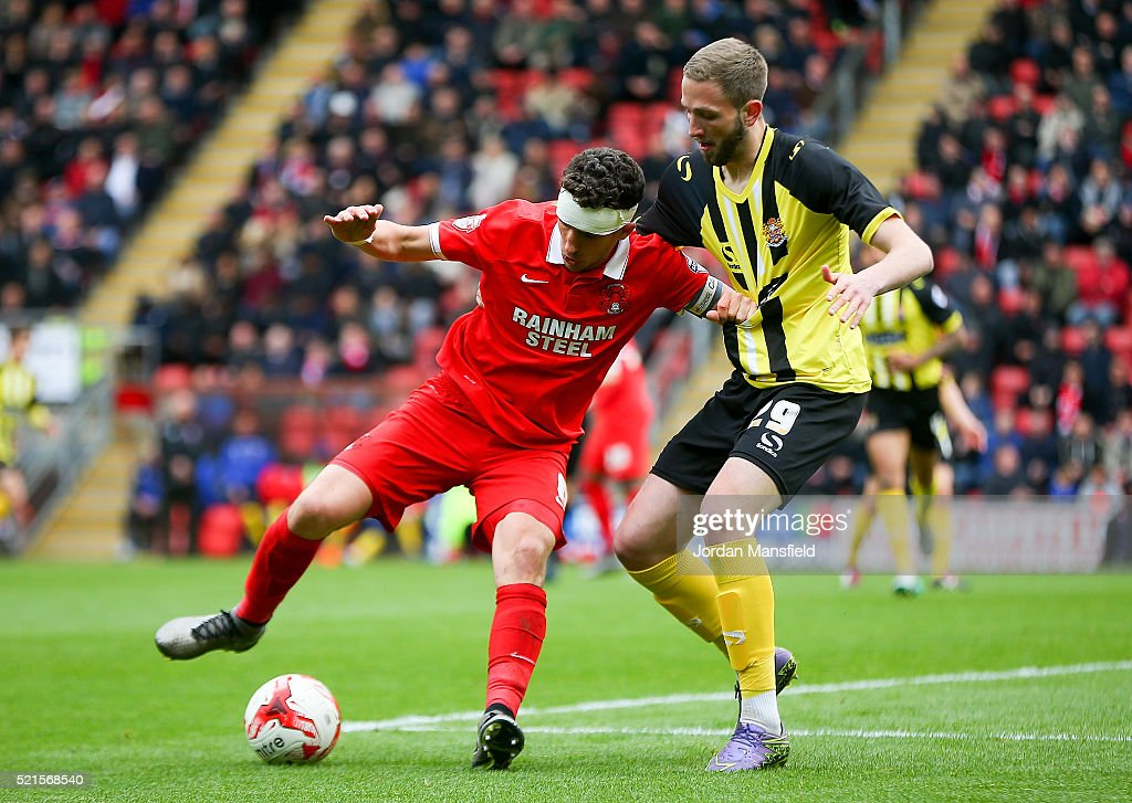 Mathieu Baudry of Leyton Orient tackles with Luke Pennell of Dagenham & Redbridge during the Sky Bet League Two match between Leyton Orient and Dagenham & Redbridge at Brisbane Road on April 16, 2016 in London, England.