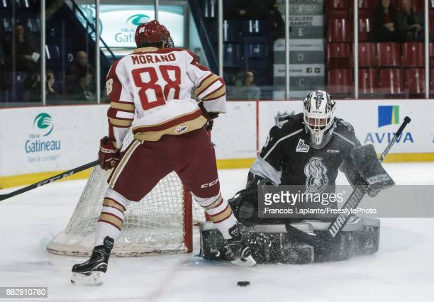 Mathieu Bellemare of the Gatineau Olympiques makes a save against Antoine Morand of the Acadie-Bathurst Titan on October 18, 2017 at Robert Guertin...