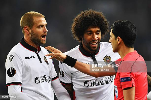 Mathieu Bodmer and Dante of Nice talk with referee Aliyar Aghayev during the UEFA Europa League match between FC Schalke 04 and OGC Nice at...