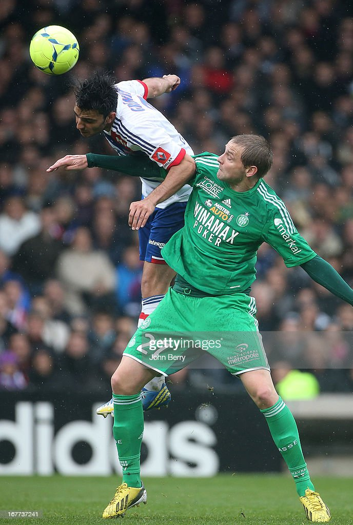 Mathieu Bodmer of Saint-Etienne and Clement Grenier of Lyon (L) in action during the Ligue 1 match between Olympique Lyonnais, OL, and AS Saint-Etienne, ASSE, at the Stade Gerland on April 28, 2013 in Lyon, France.