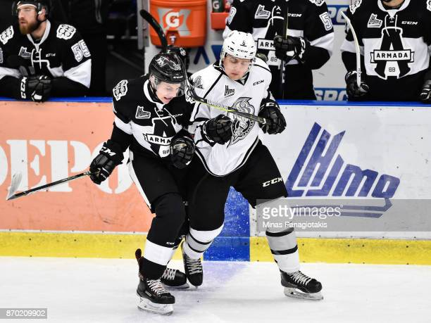 Mathieu Boissonneault of the BlainvilleBoisbriand Armada and PierOlivier Lacombe of the Gatineau Olympiques skate against each other during the QMJHL...