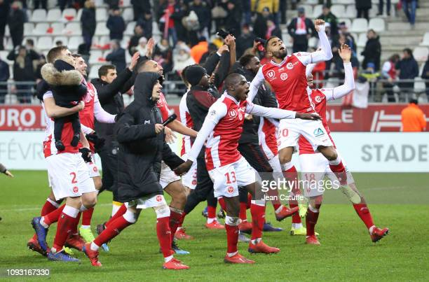 Mathieu Cafaro, Hassane Kamara, Tristan Dingome of Reims and teammates celebrate the victory following the french Ligue 1 match between Stade de...