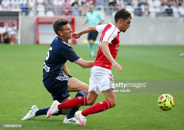 Mathieu Cafaro of Reims, Laurent Koscielny of Bordeaux during the pre-season friendly match between Stade de Reims and FC Girondins Bordeaux at Stade...