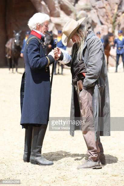 Mathieu Carriere and a background artist attend the Karl May play 'Old Surehand' press rehearsal on June 16 2017 in Bad Segeberg Germany