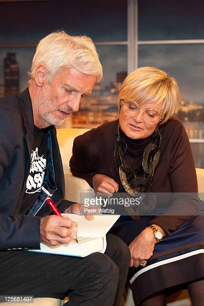 Mathieu Carriere signs his book for Gloria von Thurn und Taxis after the taping of 'Menschen bei Maischberger' Show on September 20 2011 in Cologne...