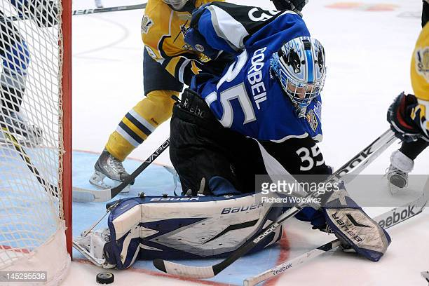 Mathieu Corbeil of the Saint John Sea Dogs stops the puck during the 2012 MasterCard Memorial Cup game against the Shawinigan Cataractes at the...