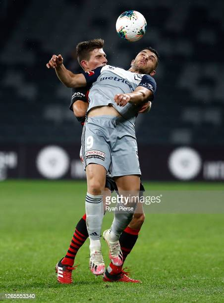 Mathieu Cordier of the Wanderers competes for the ball against Andrew Nabbout of the Victory during the round 24 A-League match between the Western...