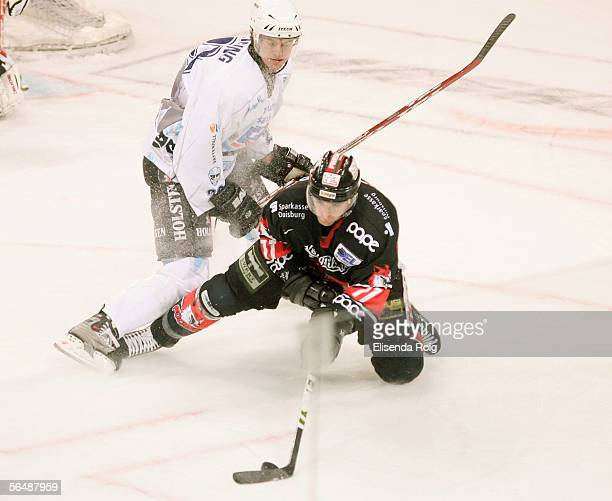 Mathieu Darche of Duisburg in action with Paul Manning of Hamburg during the DEL match between Hamburg Freezers and Fuechse Duisburg on December 26,...