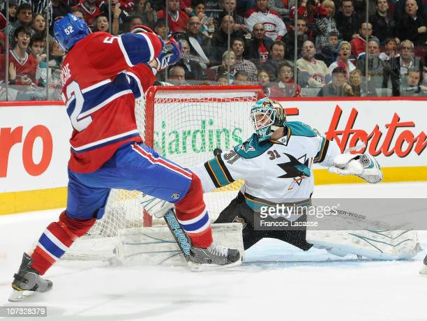 Mathieu Darche of the Montreal Canadiens scores a goal during the NHL game against the San Jose Sharks on December 4 2010 at the Bell Centre in...