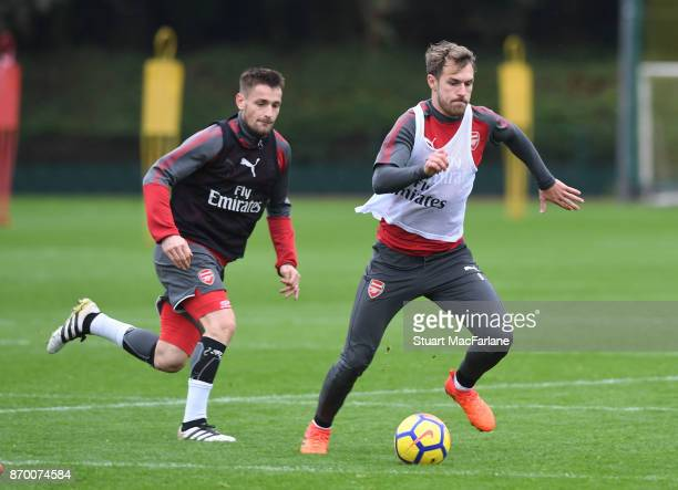 Mathieu Debuchy and Aaron Ramsey of Arsenal during a training session at London Colney on November 4 2017 in St Albans England