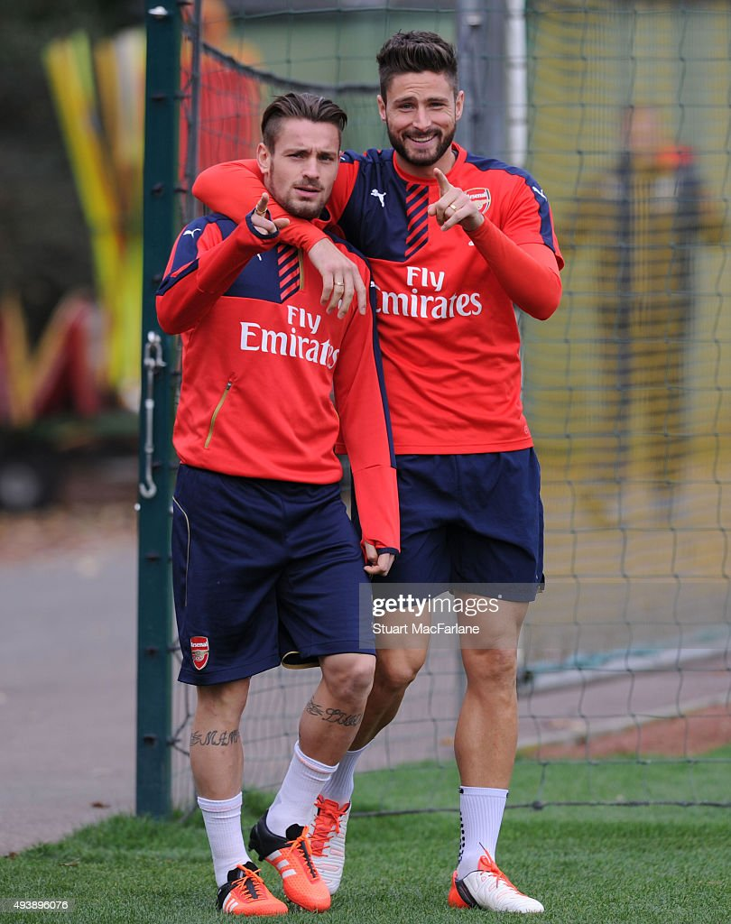 Mathieu Debuchy and Olivier Giroud of Arsenal before a training session at London Colney on October 23, 2015 in St Albans, England.