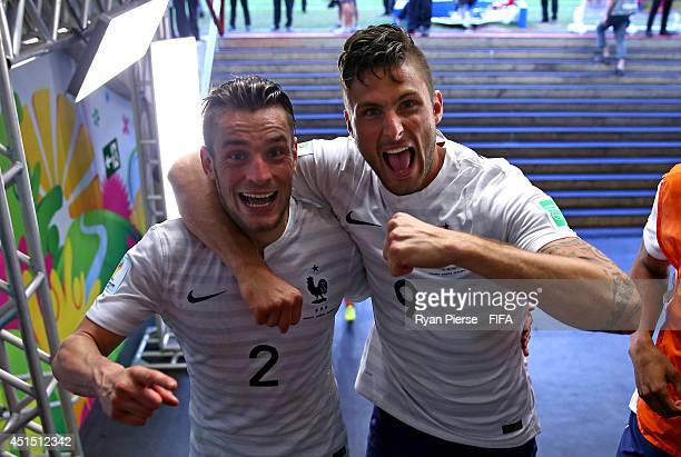 Mathieu Debuchy and Olivier Giroud of France celebrate the 2-0 win in the tunnel after the 2014 FIFA World Cup Brazil Round of 16 match between...