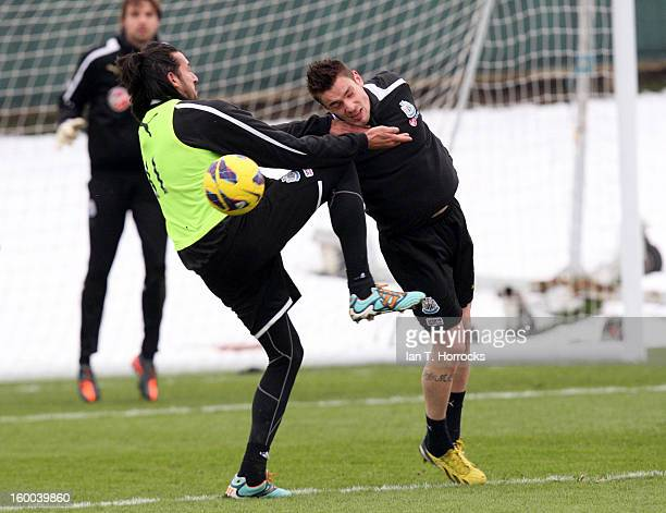 Mathieu Debuchy defends against Jonas Gutierrez during a Newcastle United training session on January 25 2013 in Newcastle upon Tyne England