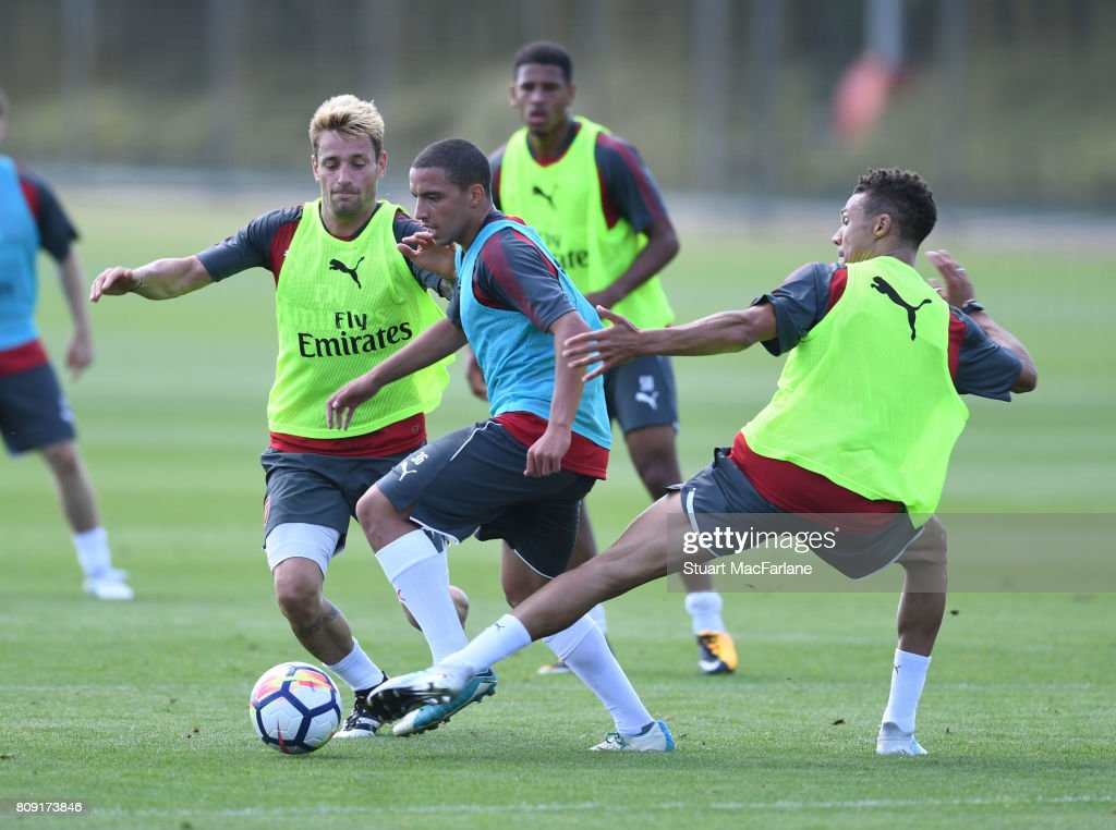 Mathieu Debuchy, Ismael Bennacer and Kieran Gibbs of Arsenal during a training session at London Colney on July 5, 2017 in St Albans, England.