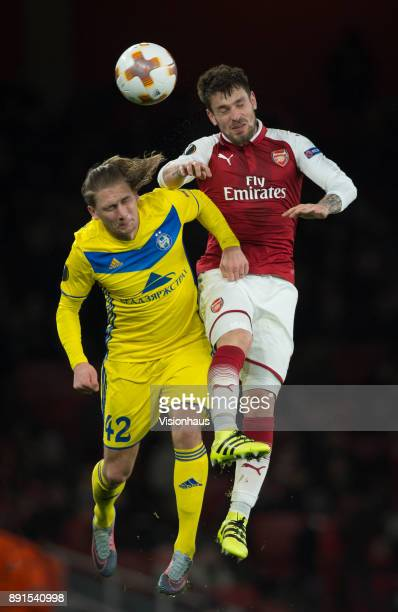 Mathieu Debuchy of Arsenal and Maksim Volodko of FC BATE Borisov in action during the UEFA Europa League group H match between Arsenal FC and BATE...