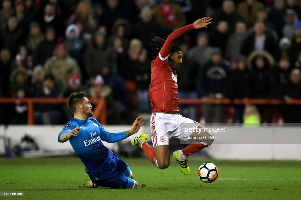 Mathieu Debuchy of Arsenal brings down Armand Traore of Nottingham Forest leading to his team's second penalty during The Emirates FA Cup Third Round match between Nottingham Forest and Arsenal at City Ground on January 7, 2018 in Nottingham, England.