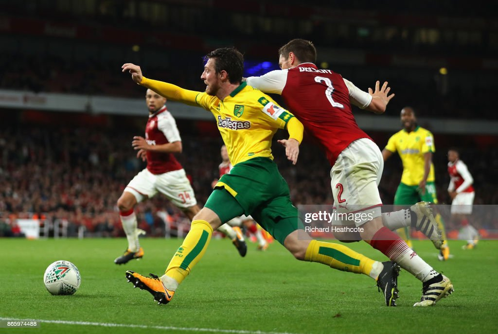 Mathieu Debuchy of Arsenal brings down James Husband of Norwich City in the box during the Carabao Cup Fourth Round match between Arsenal and Norwich City at Emirates Stadium on October 24, 2017 in London, England.