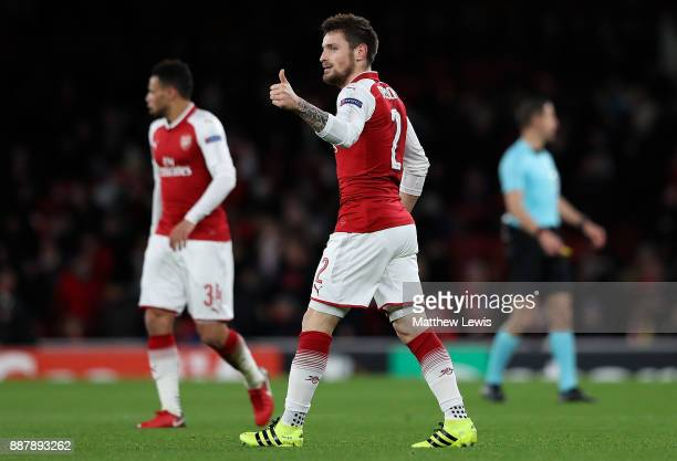 Mathieu Debuchy of Arsenal celebrates after scoring the opening goal of the game during the UEFA Europa League group H match between Arsenal FC and...