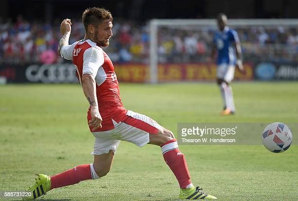 Mathieu Debuchy of Arsenal FC passes the ball against the MLS AllStars during the second half of the ATT MLS AllStar Game at Avaya Stadium on July 28...