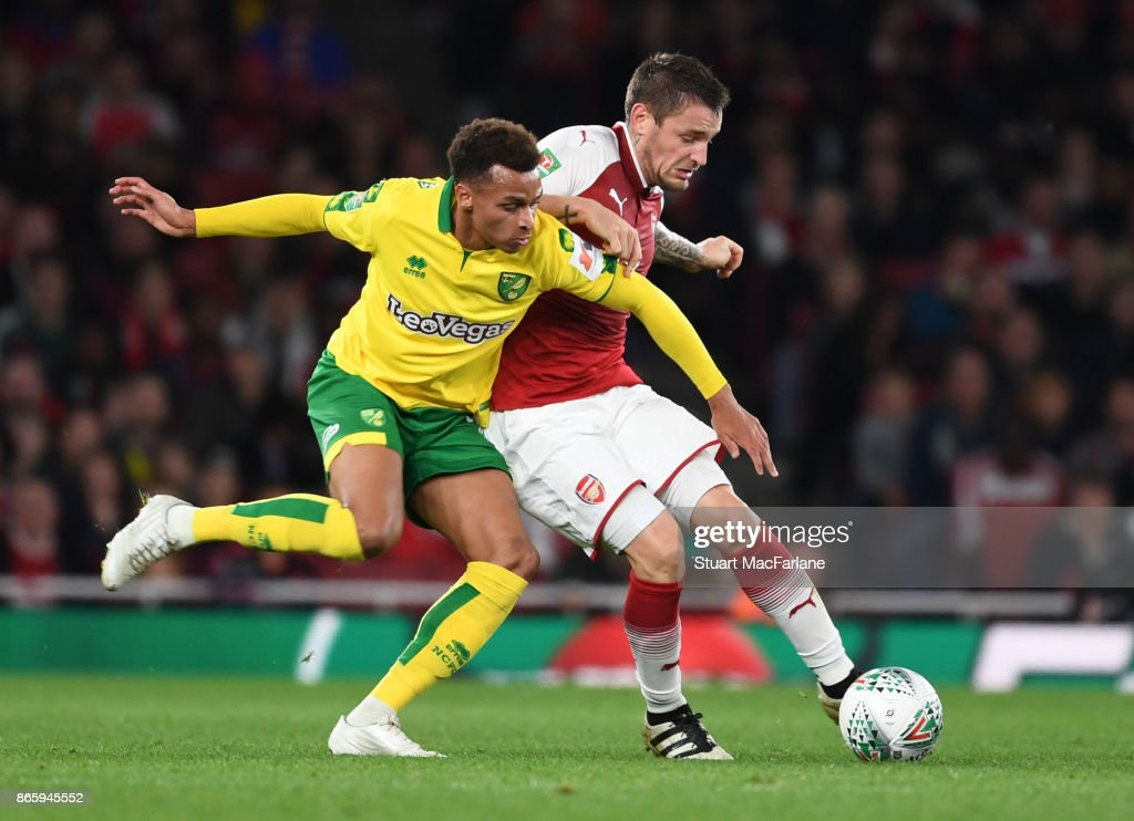 Mathieu Debuchy of Arsenal holds off Josh Murphy of Norwich during the Carabao Cup Fourth Round match between Arsenal and Norwich City at Emirates Stadium on October 24, 2017 in London, England.