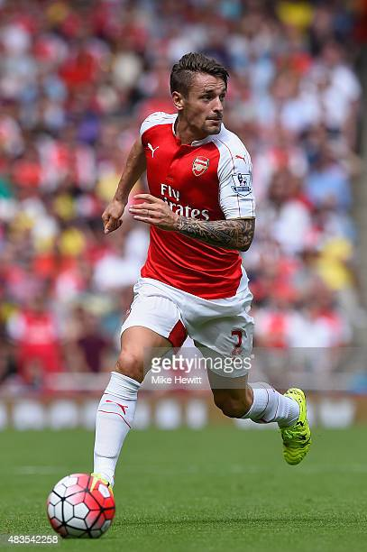 Mathieu Debuchy of Arsenal in action during the Barclays Premier League match between Arsenal and West Ham United at Emirates Stadium on August 9...